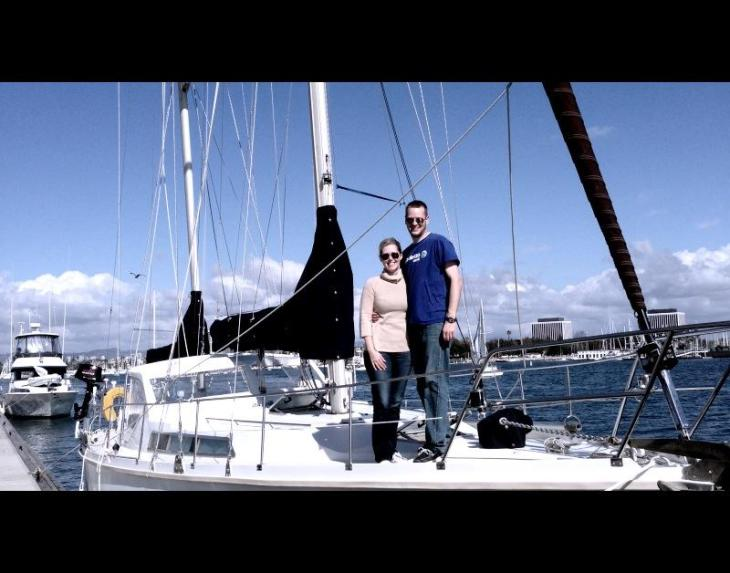 Jeremy and Erika standing on deck of Cerulean